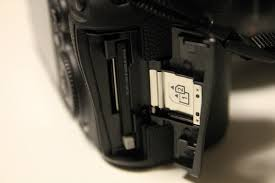 DSLR sd card slot memory card won't stay locked in place